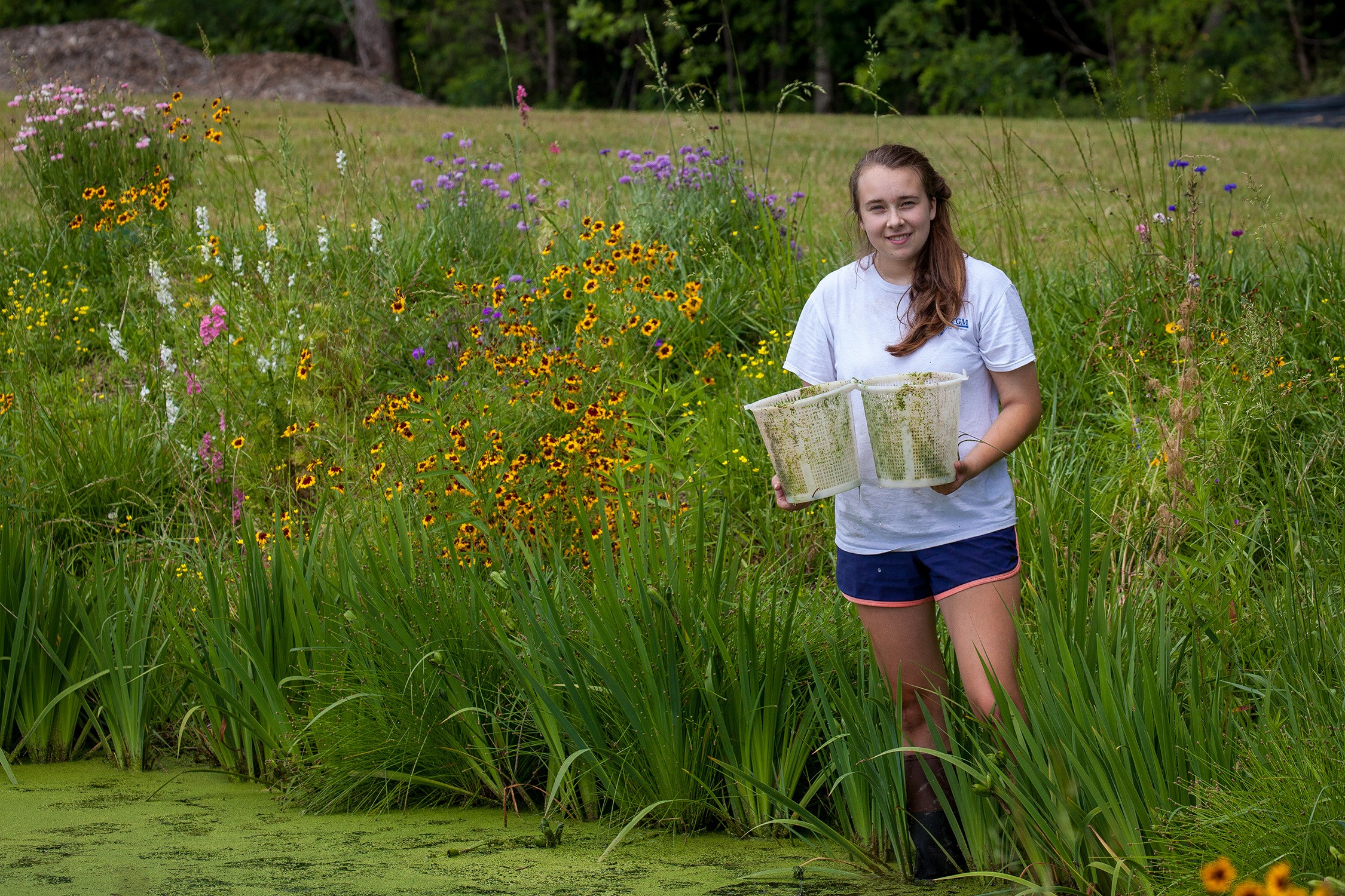 Emma Zeitler, C'20, conducts research in Sewanee's constructed wetland. Photo by Buck Butler