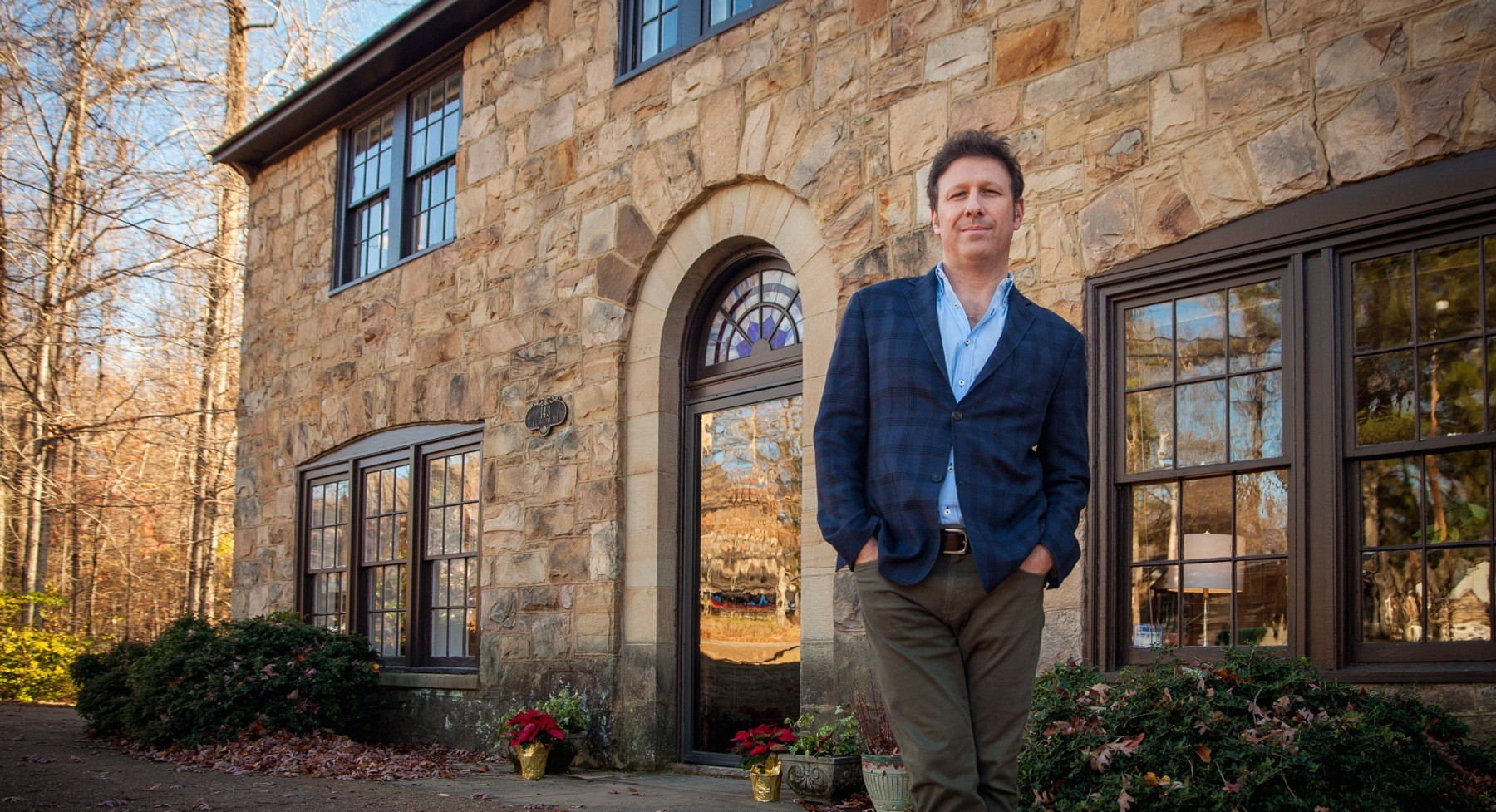 Adam Ross in front of the Watson House, the new home of the Sewanee Review.