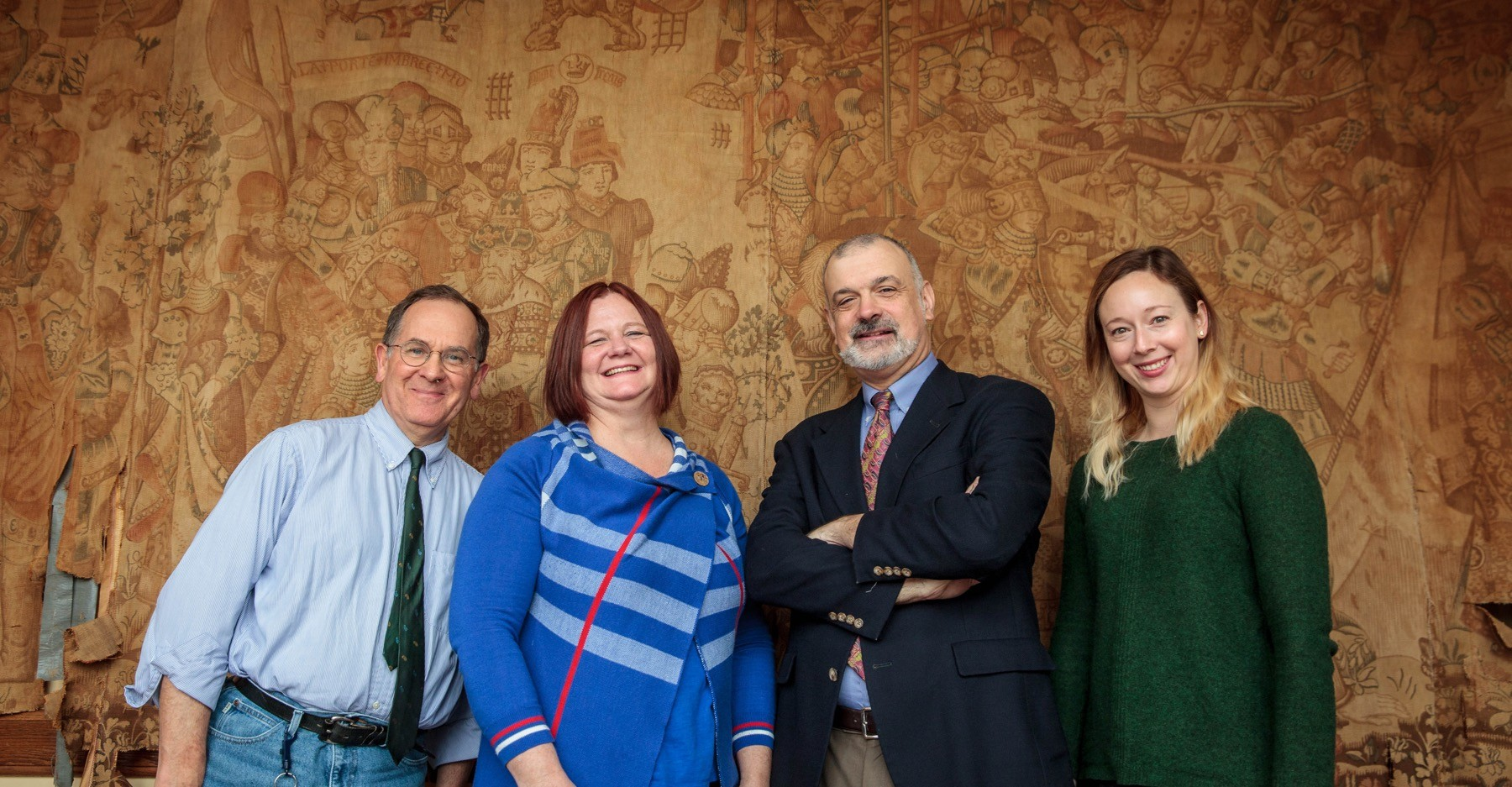 The faculty group leading the study of the tapestry includes (from left to right): Art History Professor Greg Clark, Theatre Professor Jennifer Matthews, Classics Professor Chris McDonough, and Humanities Teaching Professor Stephanie Batkie. Not pictured: Chemistry Professor Rob Bachman. Photo by Buck Butler