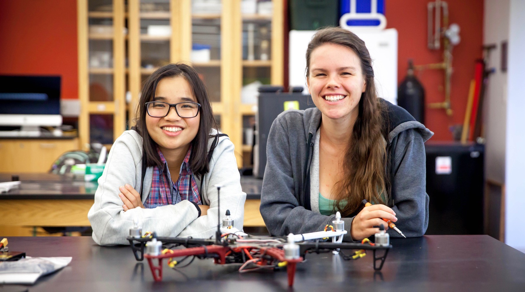 Lam Ngo, left, and Tieta Keetle with the Kashmir World Foundation drone they are building with the help of Aliyah Pandolfi. Photo by Buck Butler