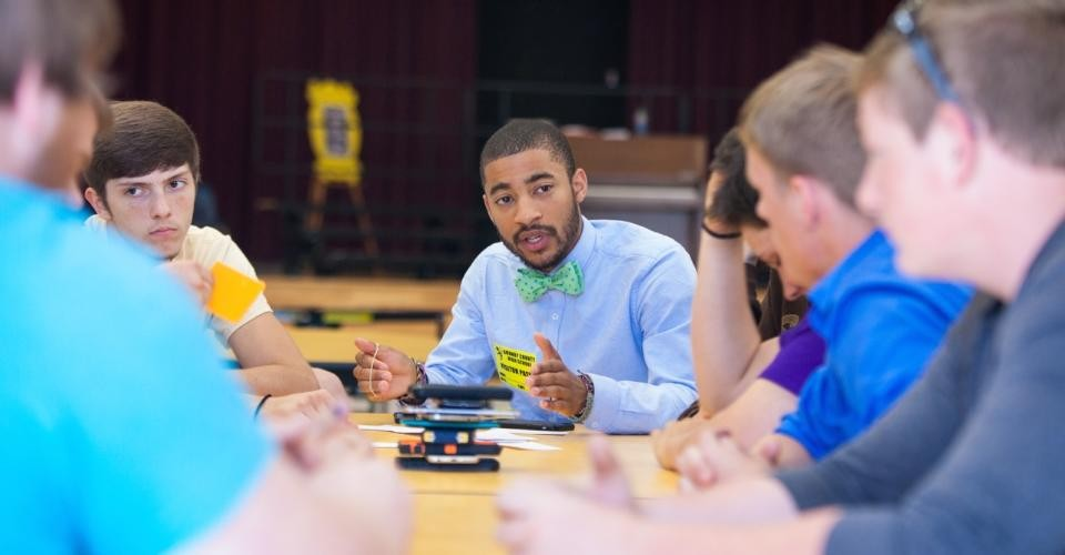 """Jewlz Davis leads a small-group discussion at Grundy County High School. """"We're trying to open the scope of masculinity,"""" he says."""